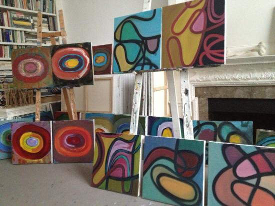 View of small abstract paintings in studio