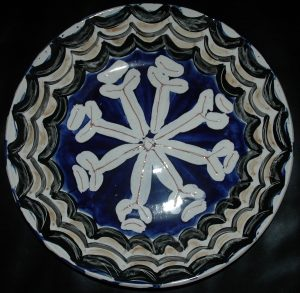 Ceramic Plate Round plate, abstract flower like white shape on blue ground and patterned border