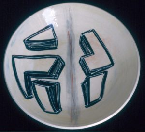 Round plate, abstract geometric shapes on white ground